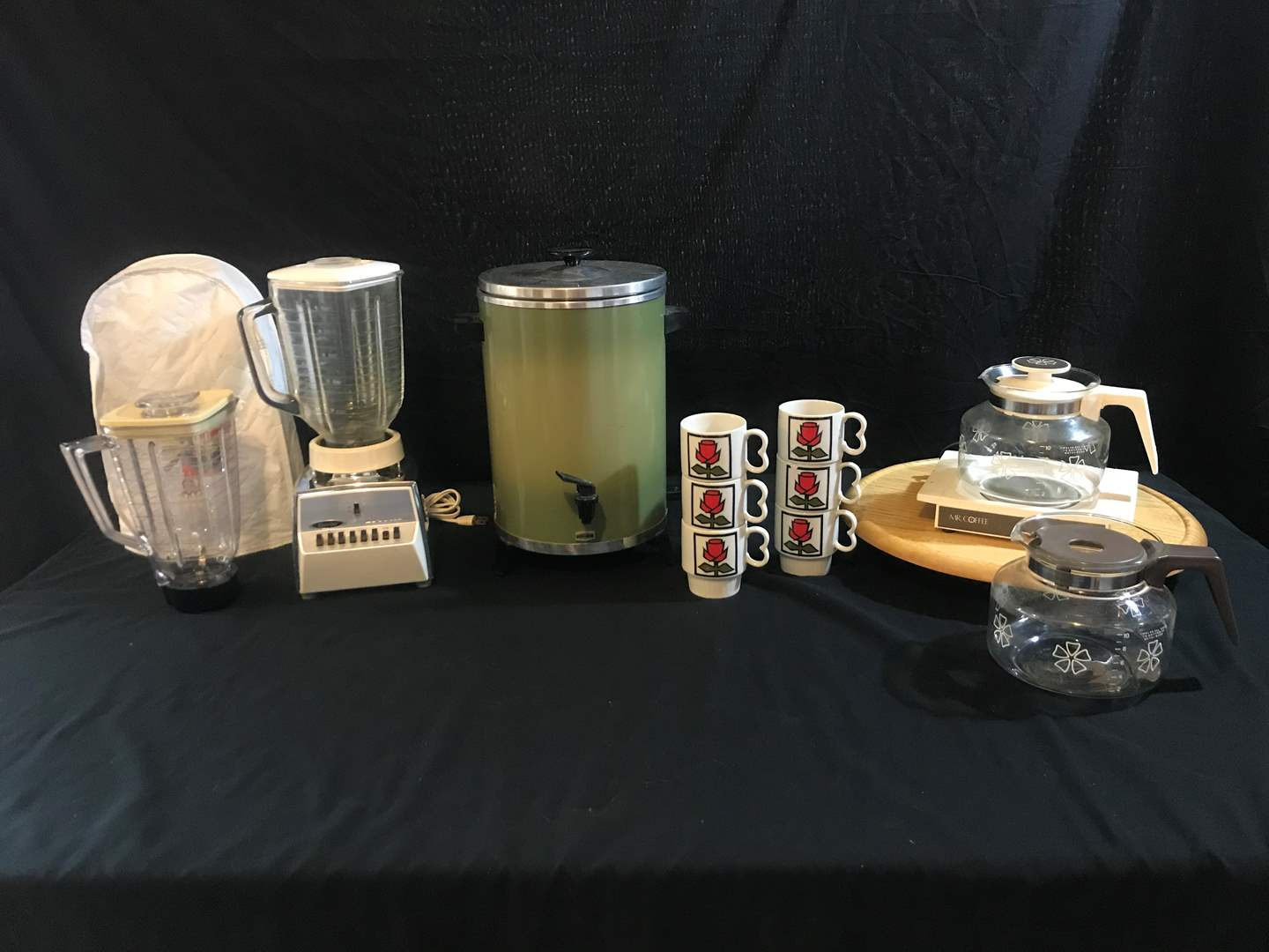 Lot # 67 - Westbend Coffee Maker, Osterizer Blender, Mr. Coffee Pot Warmer & Coffee Mugs (main image)