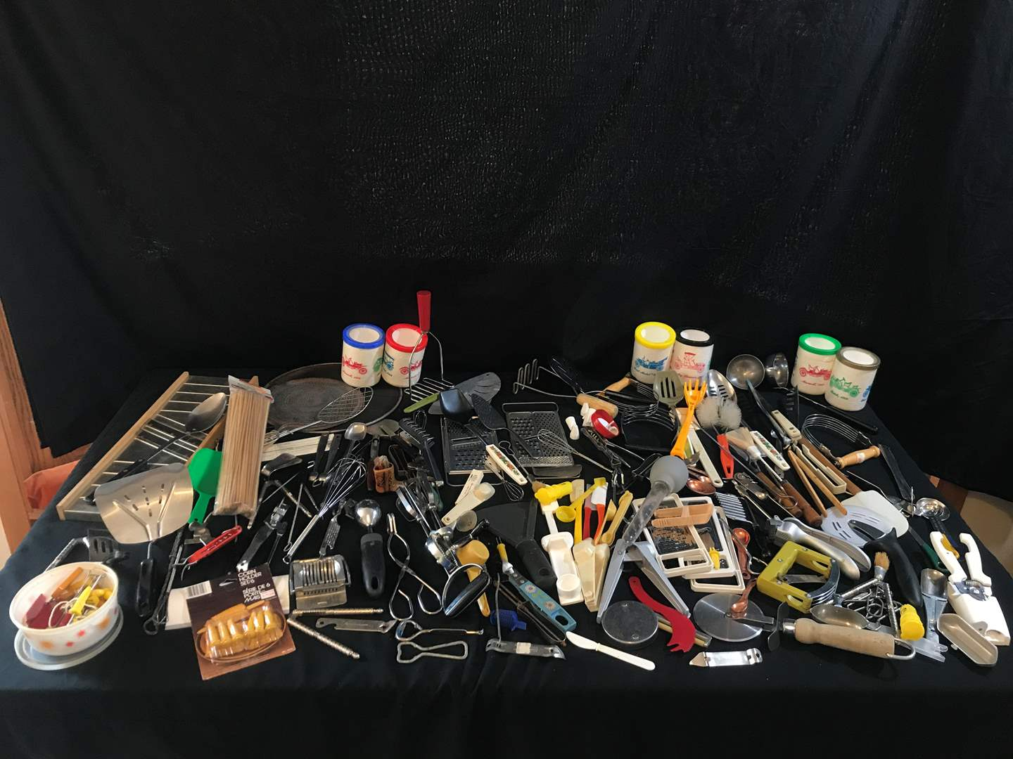 Lot # 69 - Large Lot of Kitchen Utensils: Measuring Spoons, Spatulas, Can Openers, Potato Masher & More.. (main image)