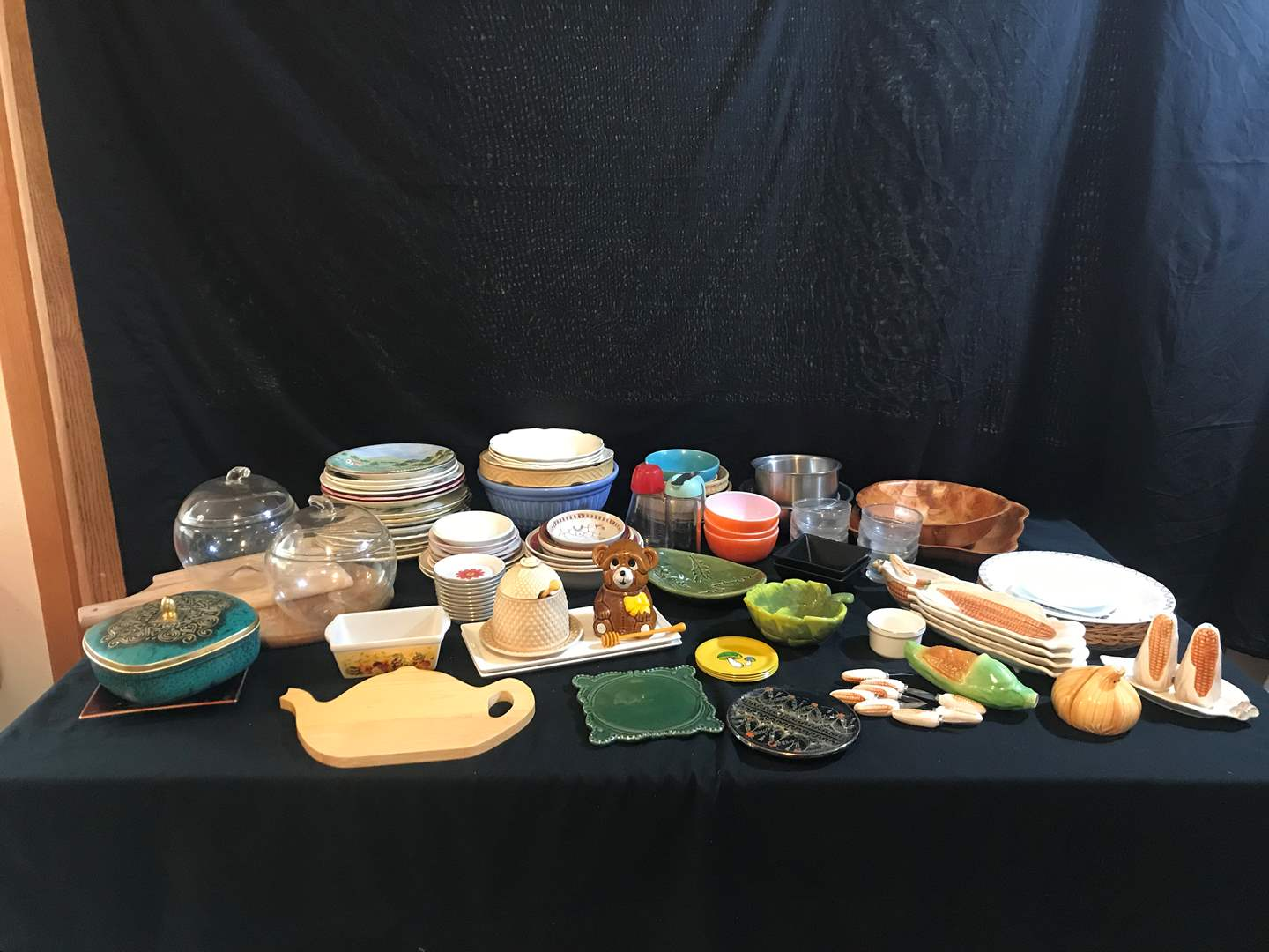 Lot # 76 - Misc. Kitchen Items: Plates, Bowls, Pie Plate, Serving Dishes, Honey Jars, Cutting Boards & More.. (main image)