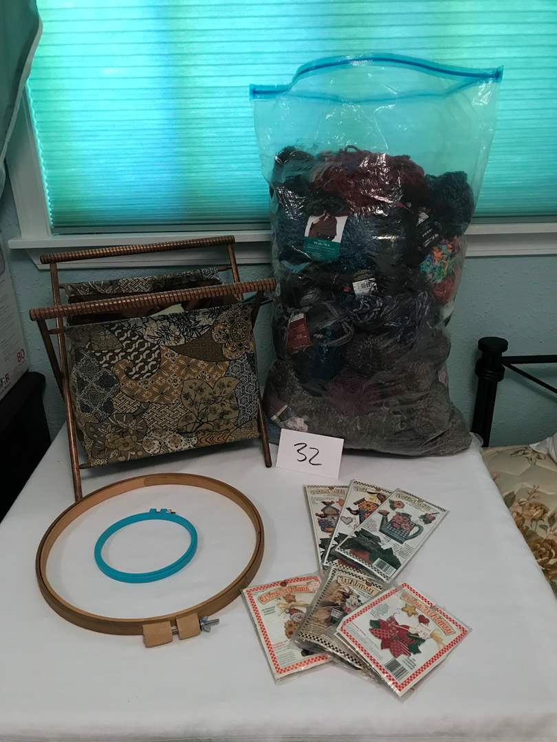 Lot # 32 - Large bag of new yarn, knitting basket, patterns, misc. (main image)