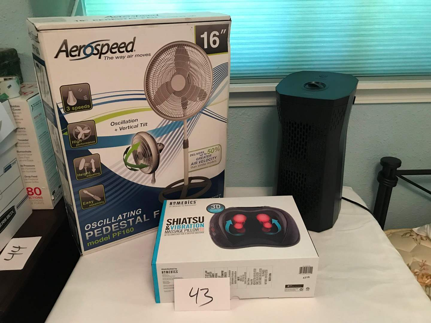 "Lot # 43 - NIB Homedics massage pillow, Hunter air purifier, NIB Aero speed PF60 16"" pedestal fan (main image)"
