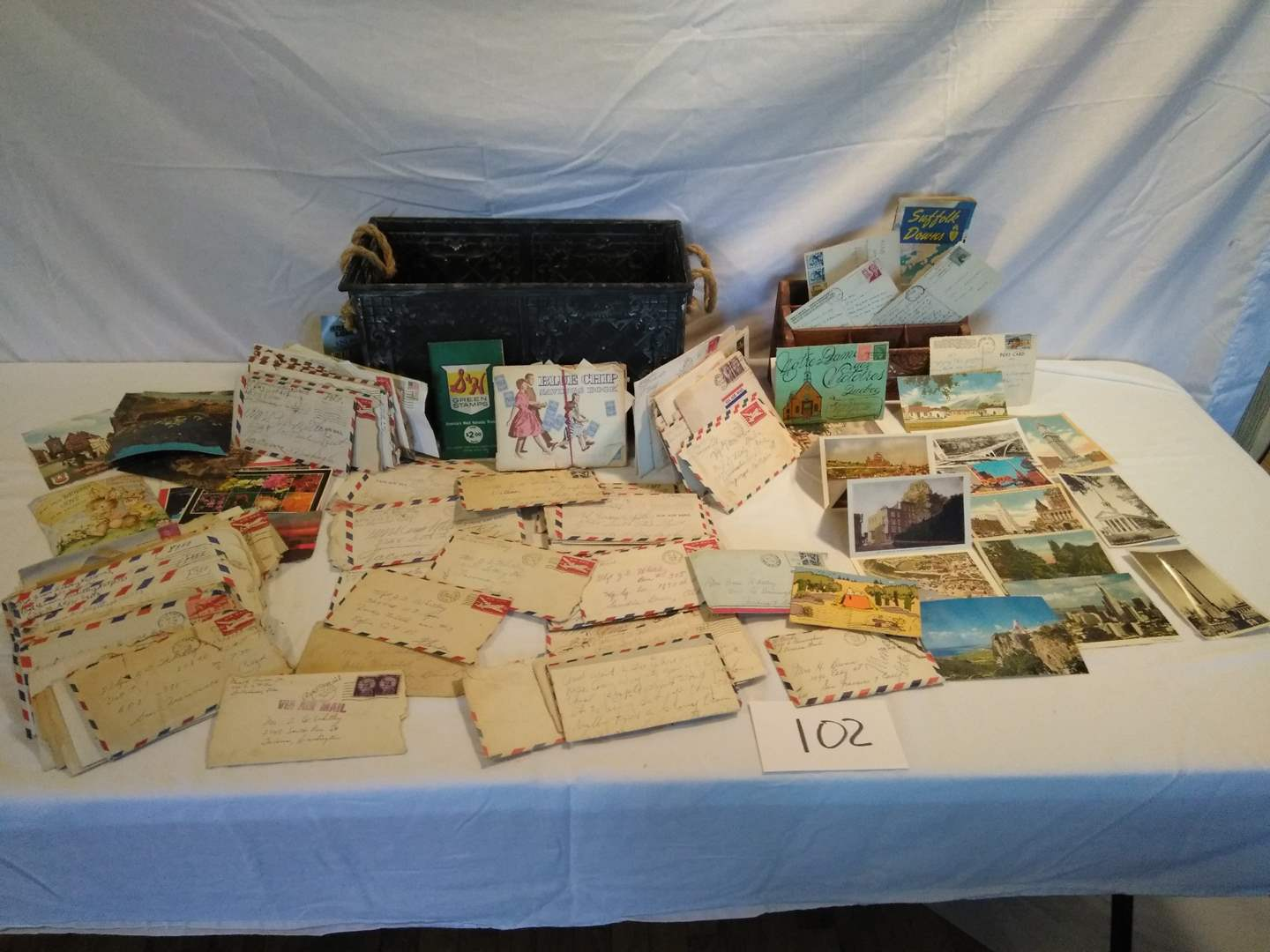 Lot # 102 - Vintage: Postcards, old letters, tin box, S&H green stamps, blue chips savings book, more (main image)