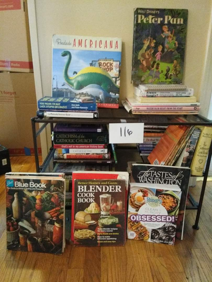 Lot # 116 - Cookbooks, gardening, Peter Pan, religious, more. Rack included (main image)