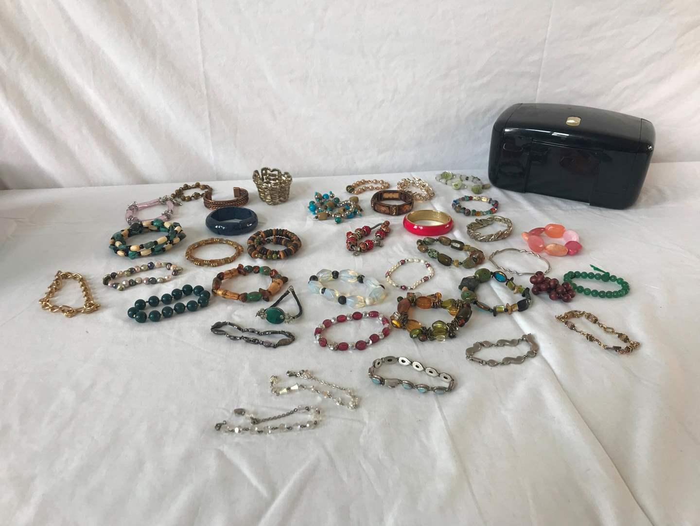 Lot # 303 - Nice Assortment of Costume Jewelry Bracelets.  (main image)