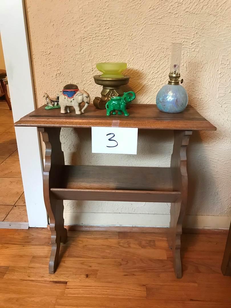 Lot # 3 - Vintage wood side table/magazine rack. Small oil lamp, knick knacks. Table 22x11x23hi (main image)