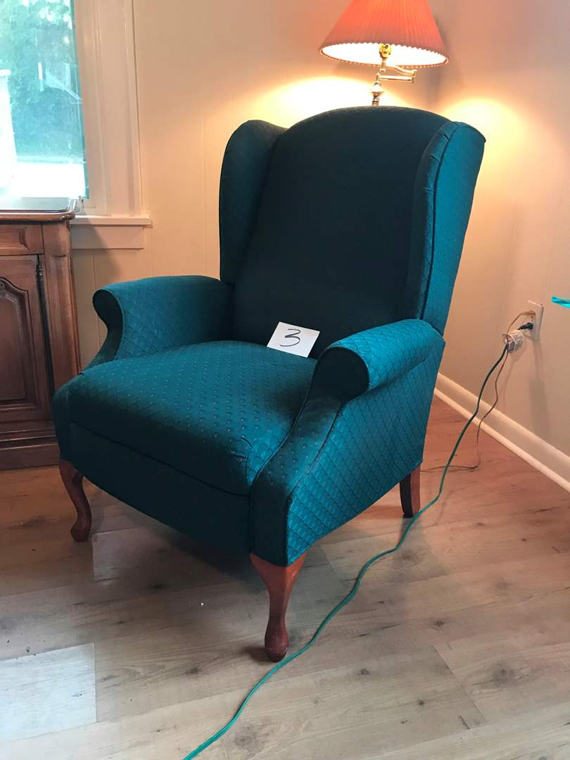 """Lot # 3 - Green Wing Back Reclining Chair - Roughly 41""""t x 28""""w x 28""""d. (main image)"""