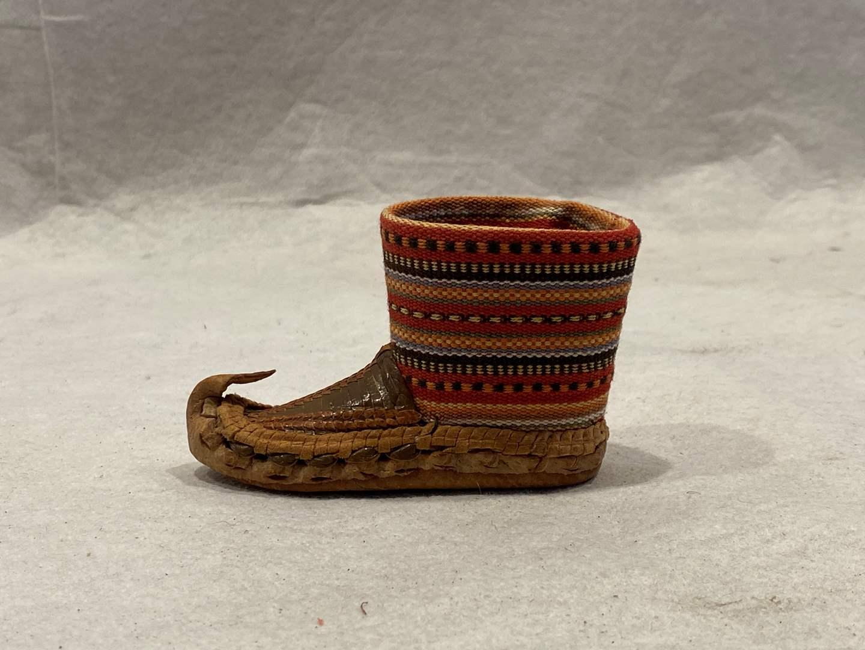 Lot # 141 Beak Boot Figurine (main image)