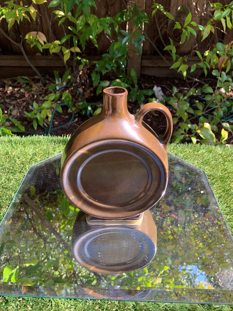 Lot # 7   Antique Round Stoneware Whiskey Jug - Brown Glaze (main image)