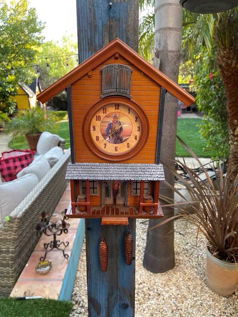 "Lot # 134 ""John Wayne""  American Icon Collectible Cuckoo Clock (main image)"