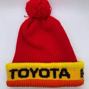 Lot # 46 Vintage TOYOTA Beanie Pom Pom Hat