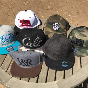 Lot # 99 Lot of 7 Snap Back Hats-Some could be Washed