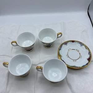 Lot # 7 Four Collectible Flower Tea Cups with Matching Saucers