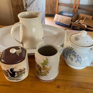 Lot # 173 Lot of Ceramic Pitchers, Mug, Canister, and Serving Platters