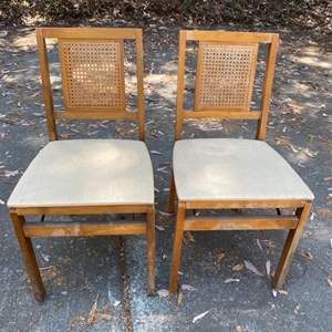 Lot # 199 Pair of 2 Light Wood Cane Back Folding Chairs