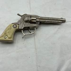 Lot # 111 Silver-Tone Texan Cap Gun With Cow Head on Handle
