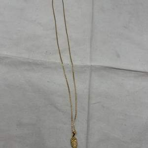 """Lot # 265 18k Pendant with """"Clear Stones"""" on a 14k Gold Chain"""
