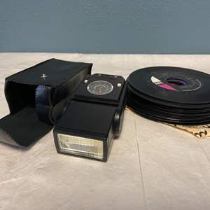 Lot # 96 Blank Vinyls and Canon Brand Speedlite (199A)