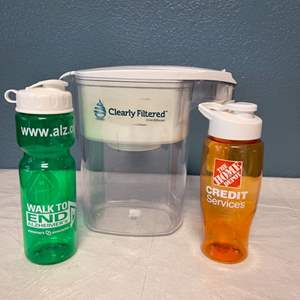 Lot # 109 Two Reusable Plastic Water Bottles and a Water Filter