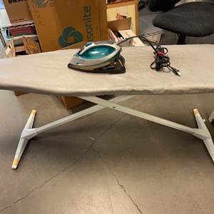 Lot # 145 Iron (Turns On) and Ironing Board
