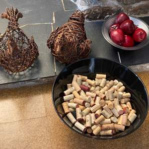 Lot # 5 Wicker Chickens, Plastic Bowl of Cork, & Glass Bowl of Wood Apples