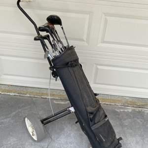 Lot # 67 Golf Clubs, Golf Bag, and Golf Bag Carrier
