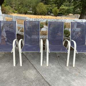 Lot # 70 Four Blue and White Outdoor Chairs