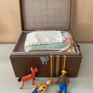 Lot # 87 Small Brown Chest Filled with Linens and Toys/Figurines