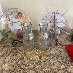 Lot # 121 Lot of Glassware - Pair of Teacups, Pair of Pitchers, and Two Plate Decors