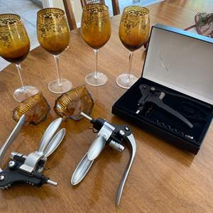 Lot # 236 Lot of Amber-Colored Wine Glasses, Le Creuset Screwpull, and Wine Openers