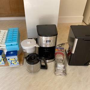 Lot # 291 Lot of Kitchen Items - Two Coffee Makers, Ice Cube Trays, Grater, Tupperware, Spice Holders, Etc.