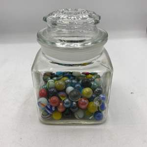 Lot # 33 Collection Of Marbles In A Glass Container
