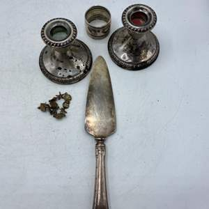 Lot # 43 Sterling Candlestick Holders, Serving Knife, Napkin Holder, and Bracelet