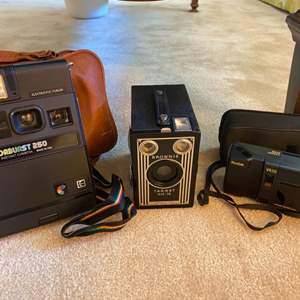 Lot # 53 Film Camera with Spare Film plus Projector
