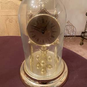 Lot # 69 Gold-Tone Clock in Glass Display Case