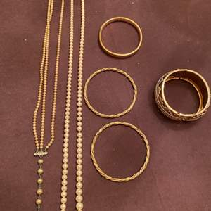 Lot # 168 Two Pearl Necklaces and Four Gold-Tone Bracelets