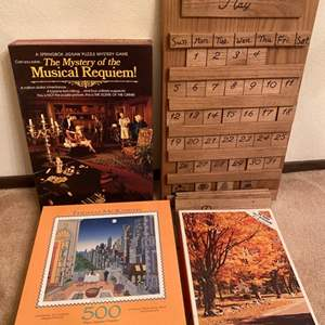 Lot # 177 Three Jigsaw Puzzles and a Changeable Wooden Calendar