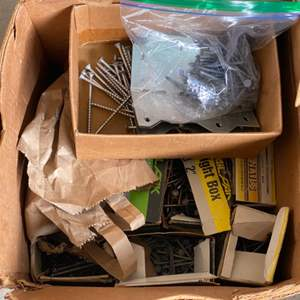 Lot # 243 Lot of Nails, Screws, and Other Building Supplies