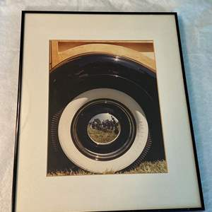 Lot # 21 Photograph of Plymouth Auto Wheel with Reflection of People