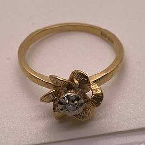 Lot # 46 10K Yellow Gold Floral Ring with Diamond or CZ) Stone
