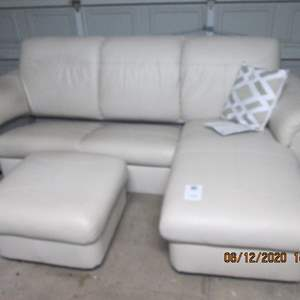 126-Ikea Leather Sofa/Chaise Unit with Ottoman (Chaise can be used to the left or right side)