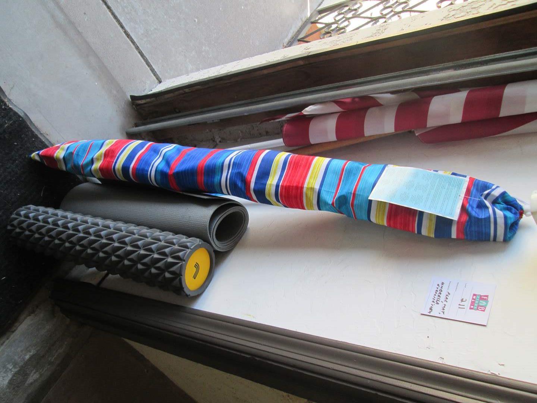 Lot # 211 - Umbrella, Mat, Flag & Pole + (main image)