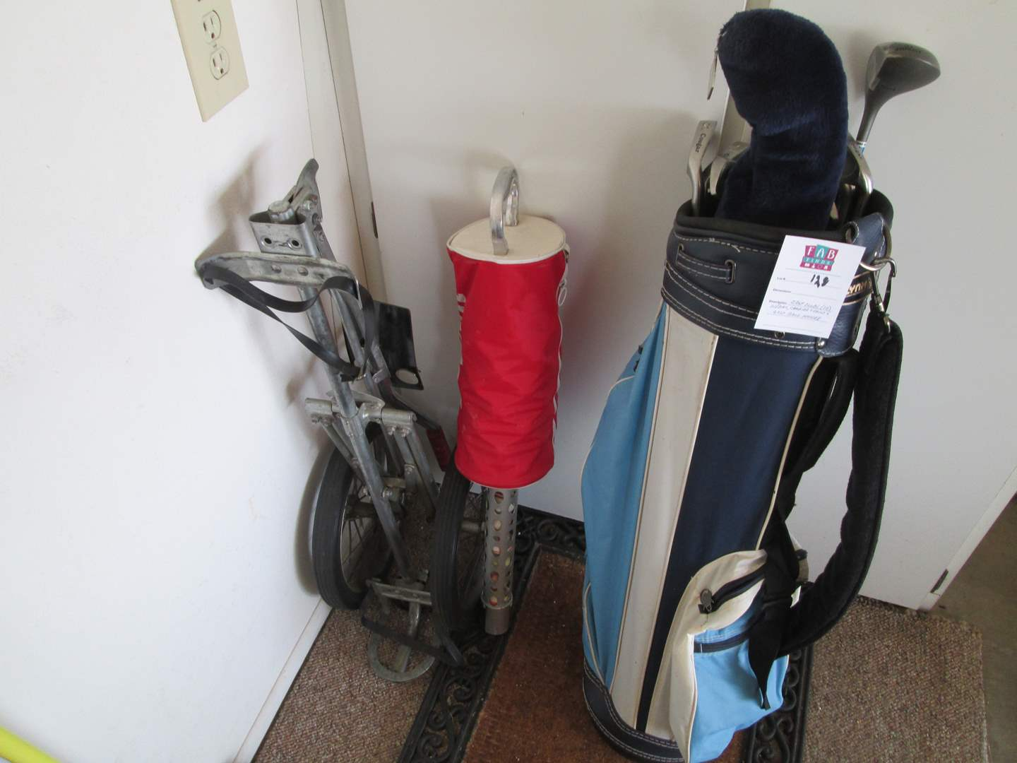Lot # 128 - Golf Clubs + Bag, Carrier, Stand & Ball Holder (main image)
