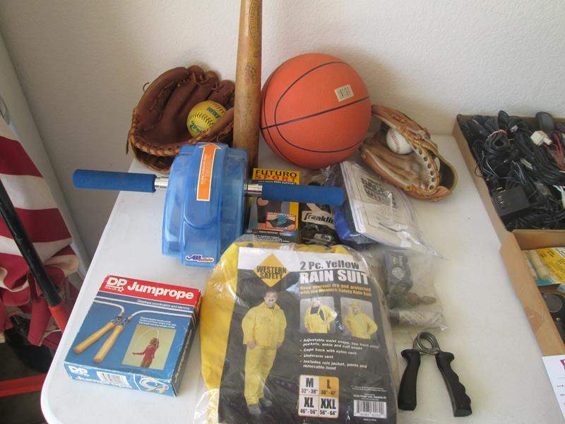 Lot # 131 - Assorted Sports Equipment + Rain Suit & Misc. (main image)