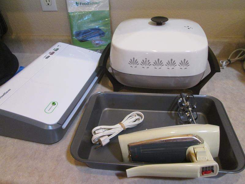 Lot # 103 - Food Saver, West Bend Electric Skillet, Hand Mixer & Pan (main image)