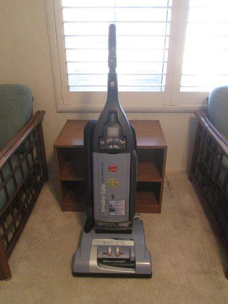 "Lot # 25 - Hoover ""Breathe Easy"" Vacuum & 2-Shelf Unit (main image)"