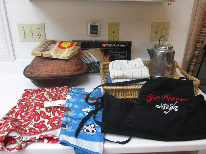 Lot # 53 - Knife Set, Aprons & Clay Pot with Cookbook (main image)