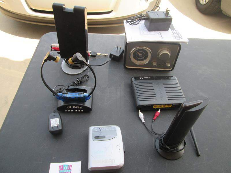 Lot # 67 - Crosley Radio, Antenna, Modems & Walkman (main image)