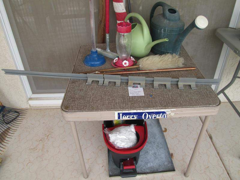 Lot # 205 - Card Table + Garden & Cleaning Supplies (main image)