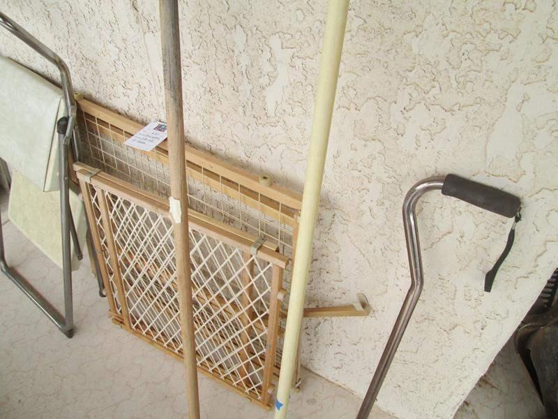 Lot # 255 - Security Gates, Step Stool, Cane & Rakes (main image)