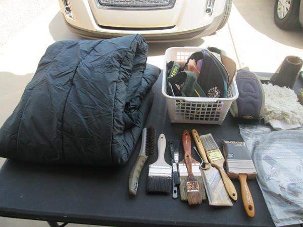 Lot # 64 - Sleeping Bag, Paint Supplies + Basket of Hats (main image)